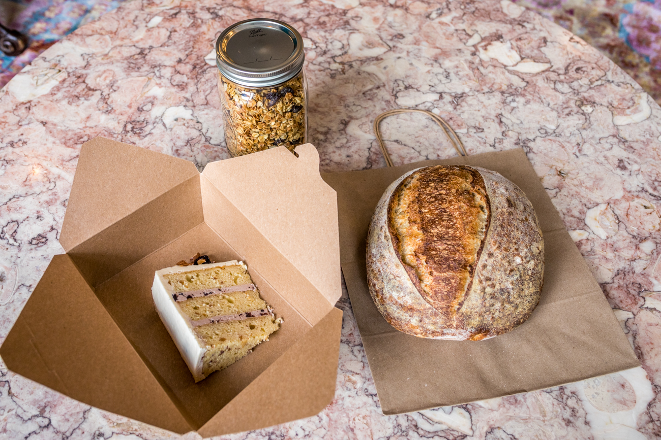 A sample of bakery items: fresh sourdough, a slice of cake, and granola / Image: Catherine Viox{ }// Published: 6.23.20