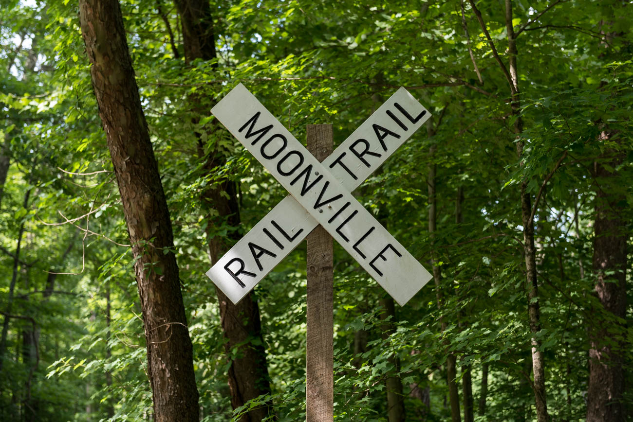 The Moonville Trail follows the path of a former rail line that once cut through Ohio's current-day Zaleski State Forest. Moonville, the town for which it's named, used to be a tiny mining community situated deep within the forests of Vinton County in Ohio (2.5 hours east of Cincinnati). In the mid-1800s, tracks were laid to accommodate faster train travel between West Virginia and Cincinnati. Because of Moonville's remote location, the town never grew beyond much more than 100 people. Following several deaths and after the mines were depleted, the last family moved out of the town in 1947. Moonville's tracks have been gone since the late-1980s and is considered a ghost town today. Visitors can still walk the path of the former train line through the woods. / Image: Mike Menke // Published: 7.8.18