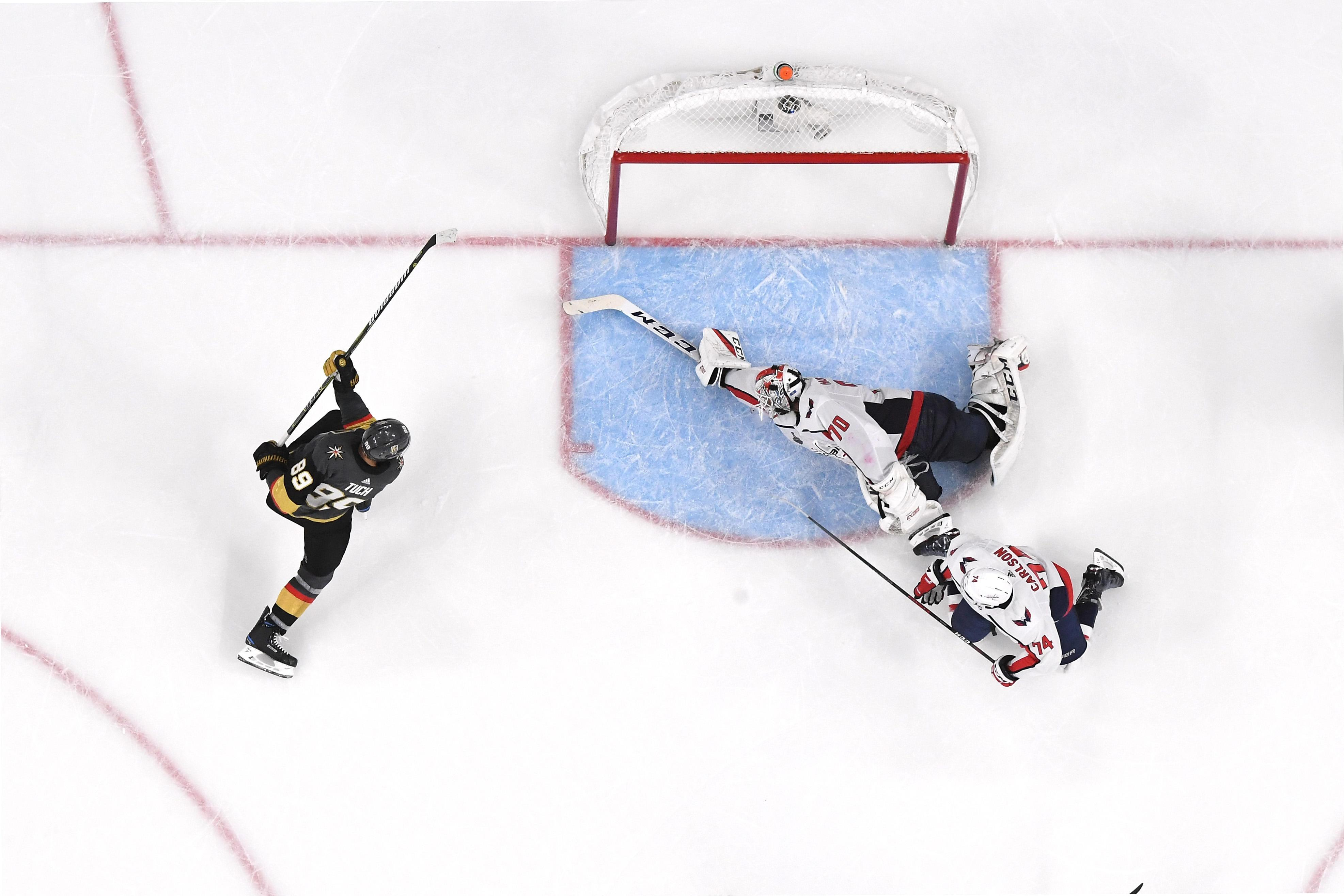 LAS VEGAS, NV - MAY 30:  Braden Holtby #70 of the Washington Capitals makes a diving stick save on Alex Tuch #89 of the Vegas Golden Knights during the third period in Game Two of the 2018 NHL Stanley Cup Final at T-Mobile Arena on May 30, 2018 in Las Vegas, Nevada. The Capitals defeated the Golden Knights 3-2.  (Photo by Ethan Miller/Getty Images)
