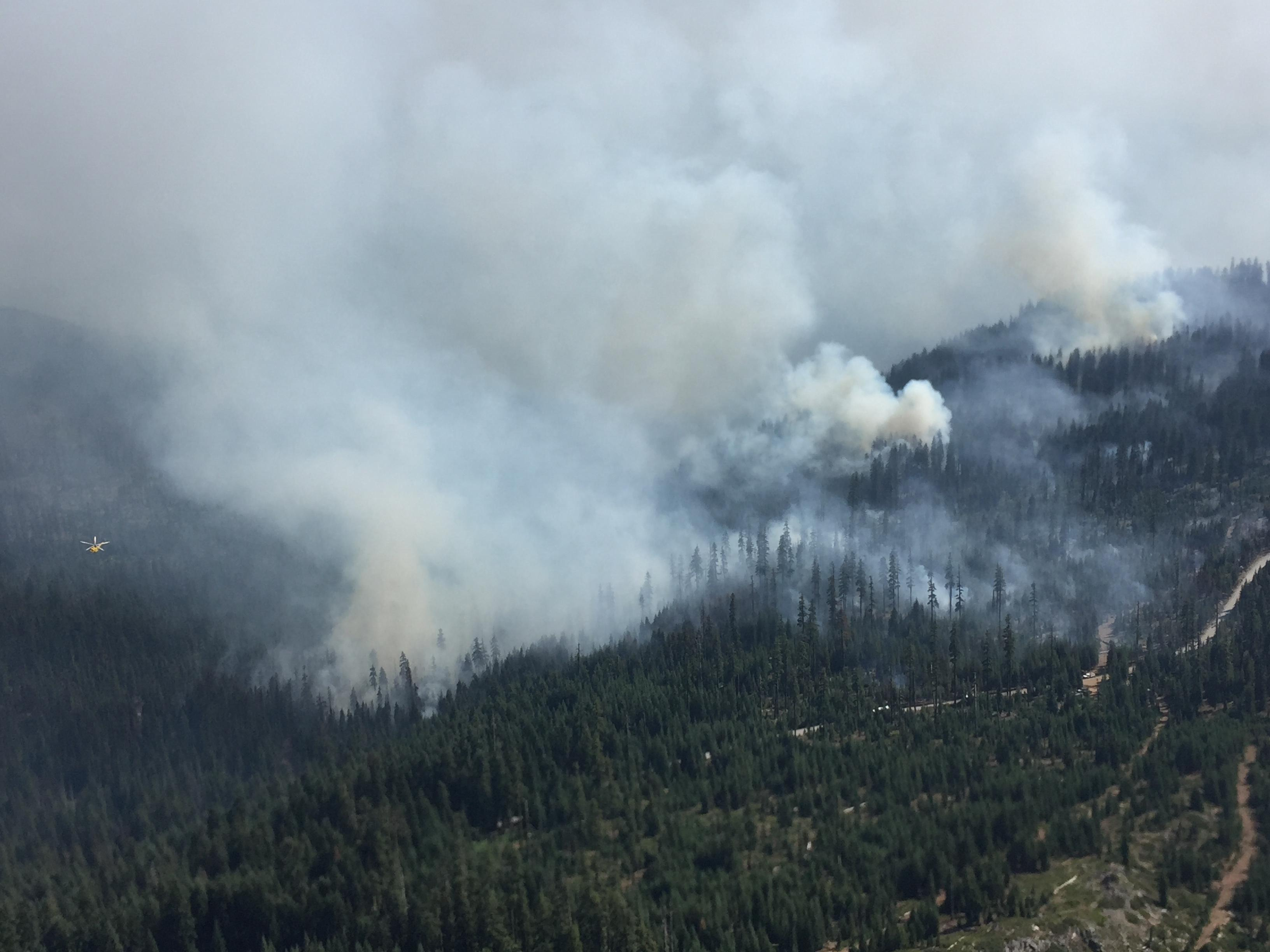 The Blanket Creek Fire is observed from the air during a recon flight with a Type 1 Helicopter carrying out water drops. (InciWeb)