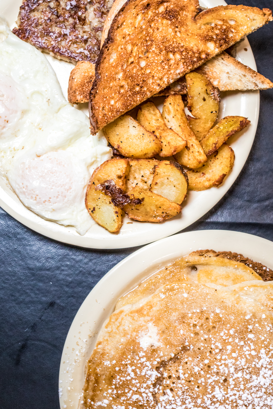 Basic Breakfast: two eggs your way, choice of one breakfast meat, home fries, and toast served with four fluffy pancakes / Image: Catherine Viox // Published: 2.1.21
