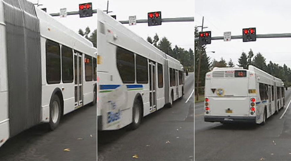 "The bus passed through double red lights on either side of a sign that reads ""Crosswalk. Stop on Red."" (SBG)"
