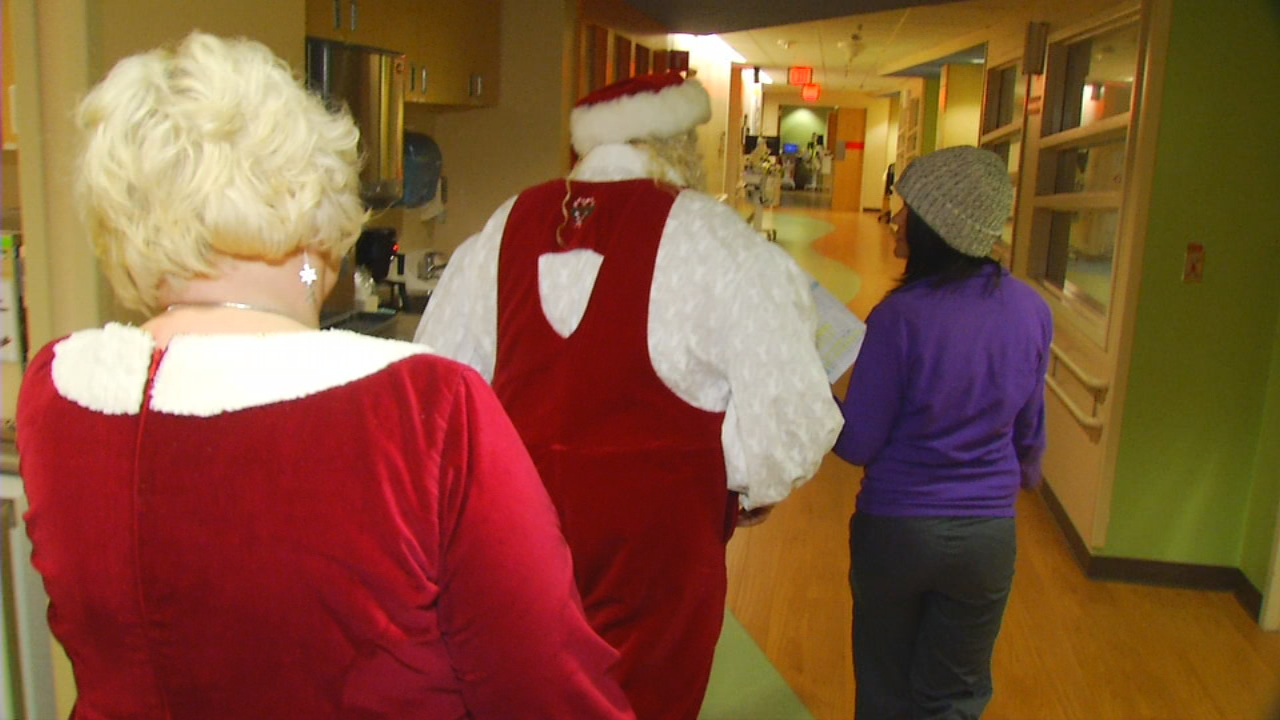 Santa and Mrs. Claus paid a special visit to Mission Hospital on Thursday to spread Christmas cheer. Each year, all of the child patients receive a visit from Santa. On Thursday, the duo popped by to see children in the cancer center and pediatric intensive care unit. (Photo credit: WLOS Staff)