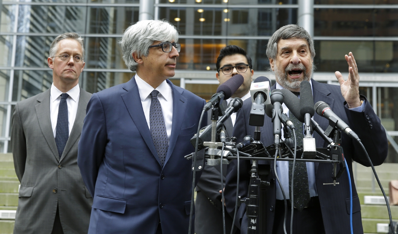 FILE - In this March 8, 2017, file photo, Mark Rosenbaum, right, an attorney for Daniel Ramirez Medina, talks to reporters outside the federal courthouse in Seattle, as fellow attorneys, from left, Ethan Dettmer, Theodore Boutrous Jr., and Luis Cortes, look on. An immigration judge says a Mexican man who was arrested despite participating in a program designed to protect those brought to the U.S. illegally as children can be released from custody pending deportation proceedings. Judge John Odell made the decision Tuesday, March 28, 2017. Lawyers for 24-year-old Daniel Ramirez Medina said they expect him to be released Wednesday, March 29. (AP Photo/Ted S. Warren, File)