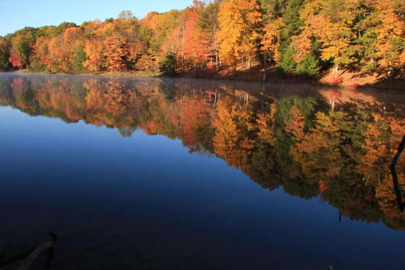 <p>PLACE: Rose Lake in Hocking Hills, OH / DISTANCE: 137 miles east of Cincinnati, a two-and-a-half-hour drive / All kinds of reflections adorn Rose Lake in Hocking Hills, Ohio. The region's 10,000 acres of unbroken forest offer an idyllic blend of fiery red Maples, blazing orange Sassafras, smoldering yellow Hickory, popping green Hemlock, and Pine. / Image: Eric Hoffman // Published: 10.19.19</p>