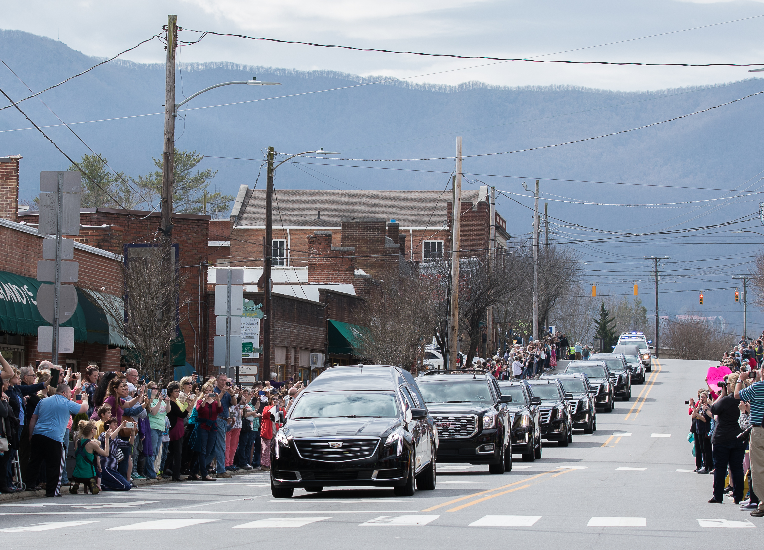 The scene in Black Mountain on Saturday, Feb. 24, as Billy Graham's motorcade drove through downtown. People lined the road to pay their respects to the late reverend, who died on Feb. 21, 2018. (Photo credit: Lindsay Higgins)
