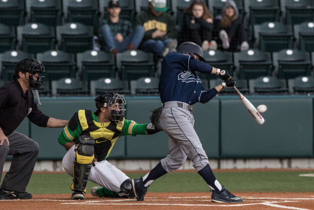 UC Irvine Anteaters outfielder Devin Pettengill (#17) hits the ball against the Oregon Ducks. Oregon Ducks pitcher Matt Mercer (#11) throws a pitch.  In the second of the three game series, the Ducks beat the UC Irvine Anteaters 6-3. Photo by Austin Hicks, Oregon News Lab