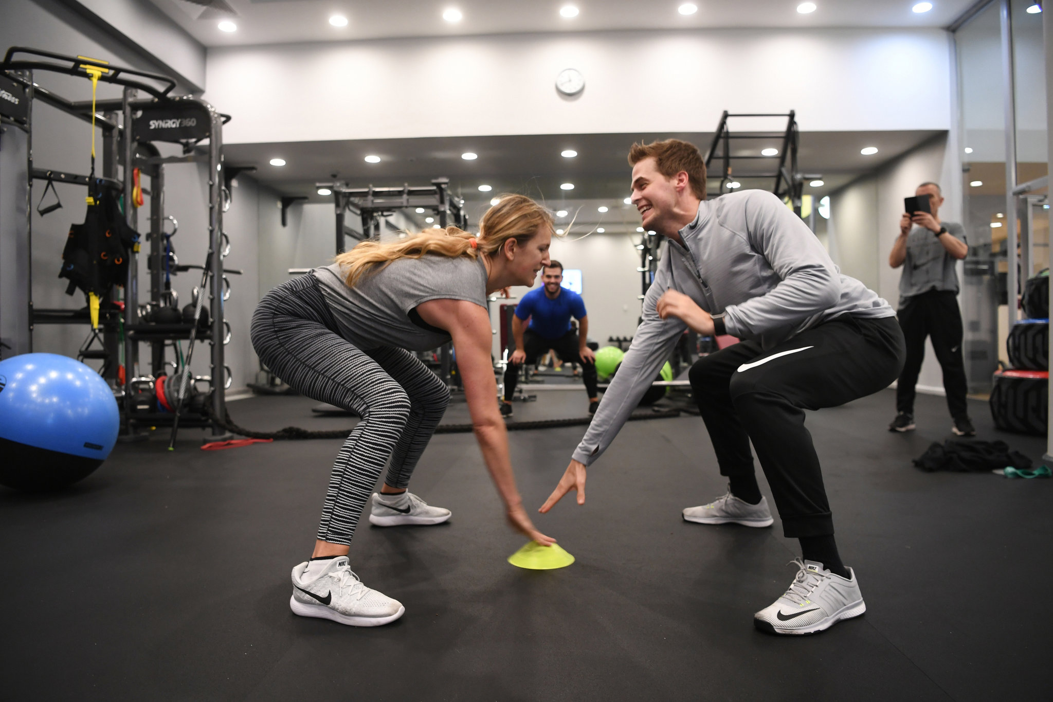 Azarenka playing a reaction game with her boyfriend, Billy McKeague, during a training session in Minsk. Once No. 1, she is on an extended break after pregnancy but is determined to rise again. Credit James Hill for The New York Times