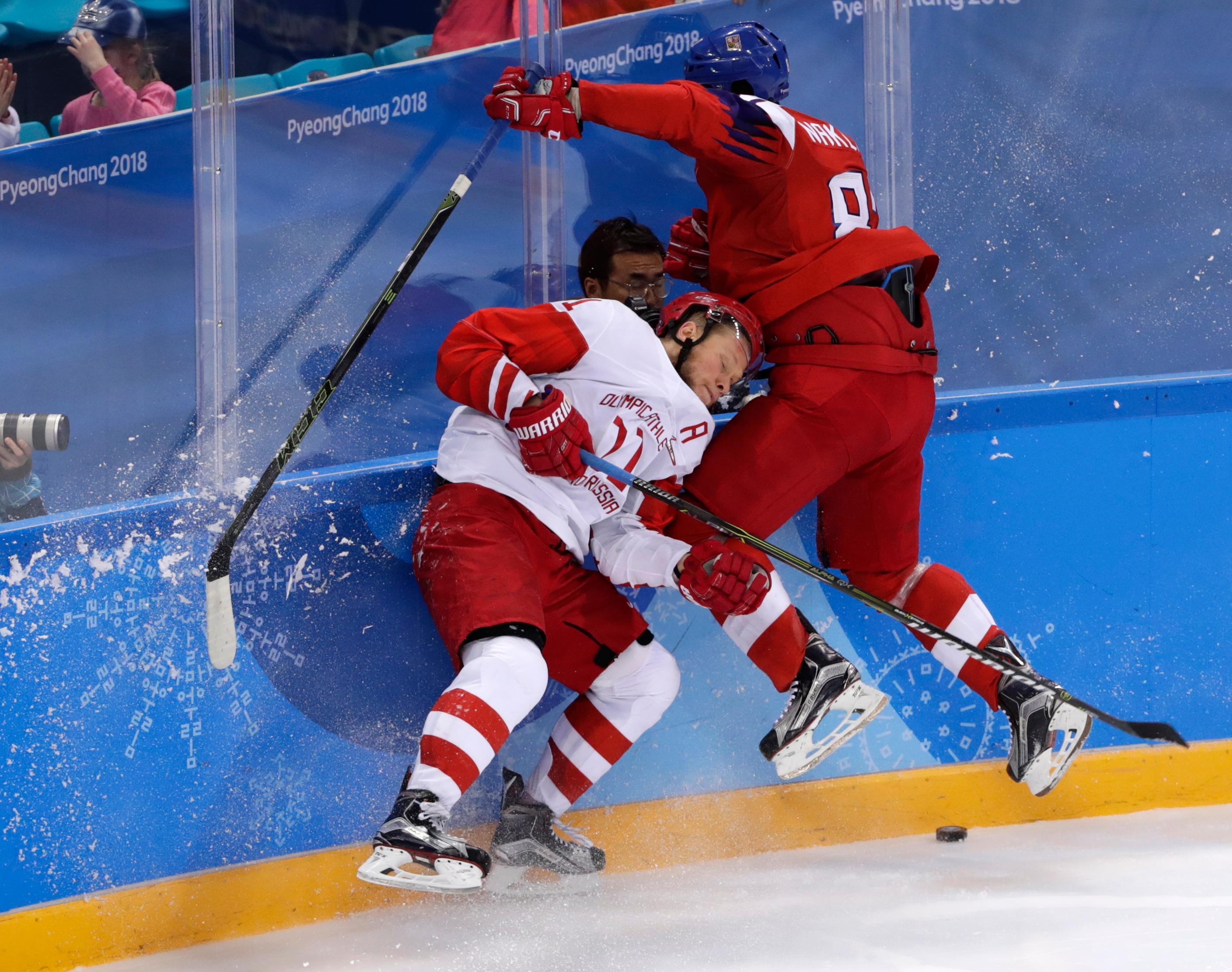 Russian athlete Sergei Andronov (11) and Jakub Nakladal (87), of the Czech Republic, collide during the second period of the semifinal round of the men's hockey game at the 2018 Winter Olympics in Gangneung, South Korea, Friday, Feb. 23, 2018. (AP Photo/Frank Franklin II)