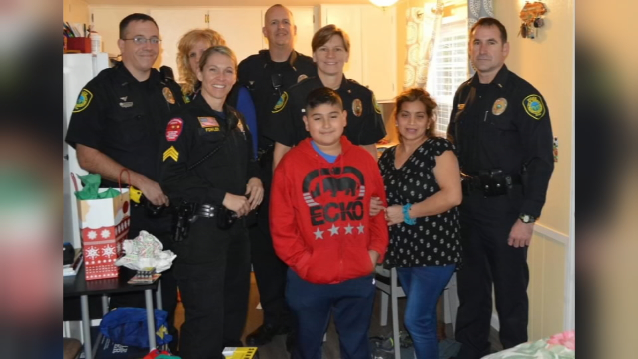 An Asheville police officer, along with some friends, made a special delivery to a family who lost so much earlier this year. (Photo credit: Asheville Police Department)