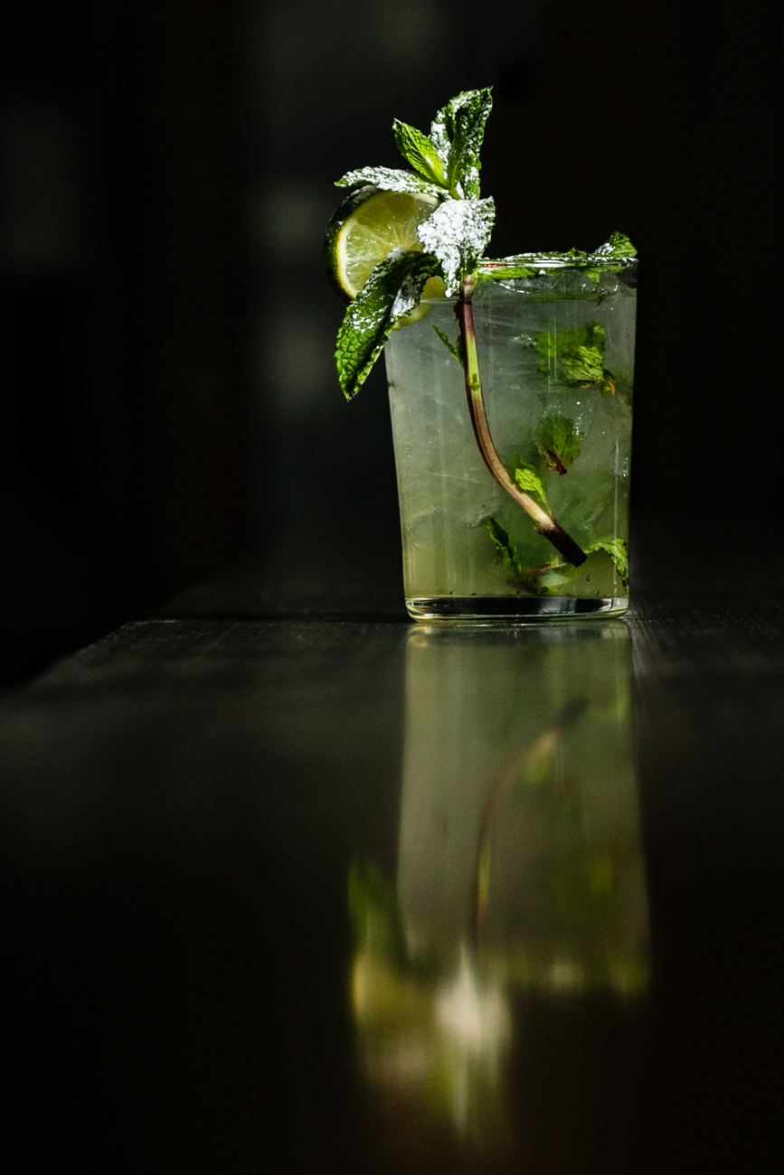 Miami Mojito made with Bacardi Silver, Bacardi Gold, fresh squeezed lime juice, fresh mint leaves, homemade simple syrup, club soda, garnished with a lime wheel and mint sprig, and sprinkled with powdered sugar{ }/ Image: Amy Elisabeth Spasoff // Published: 11.28.18