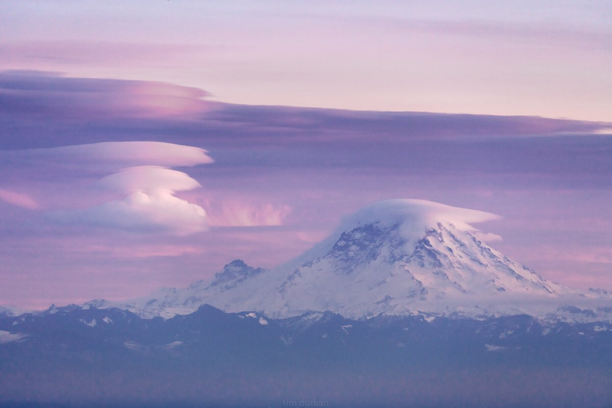 Lenticular clouds form over Mt. Rainier on Dec. 12, 2017 (Photo: Tim Durkan Photography)<p></p>
