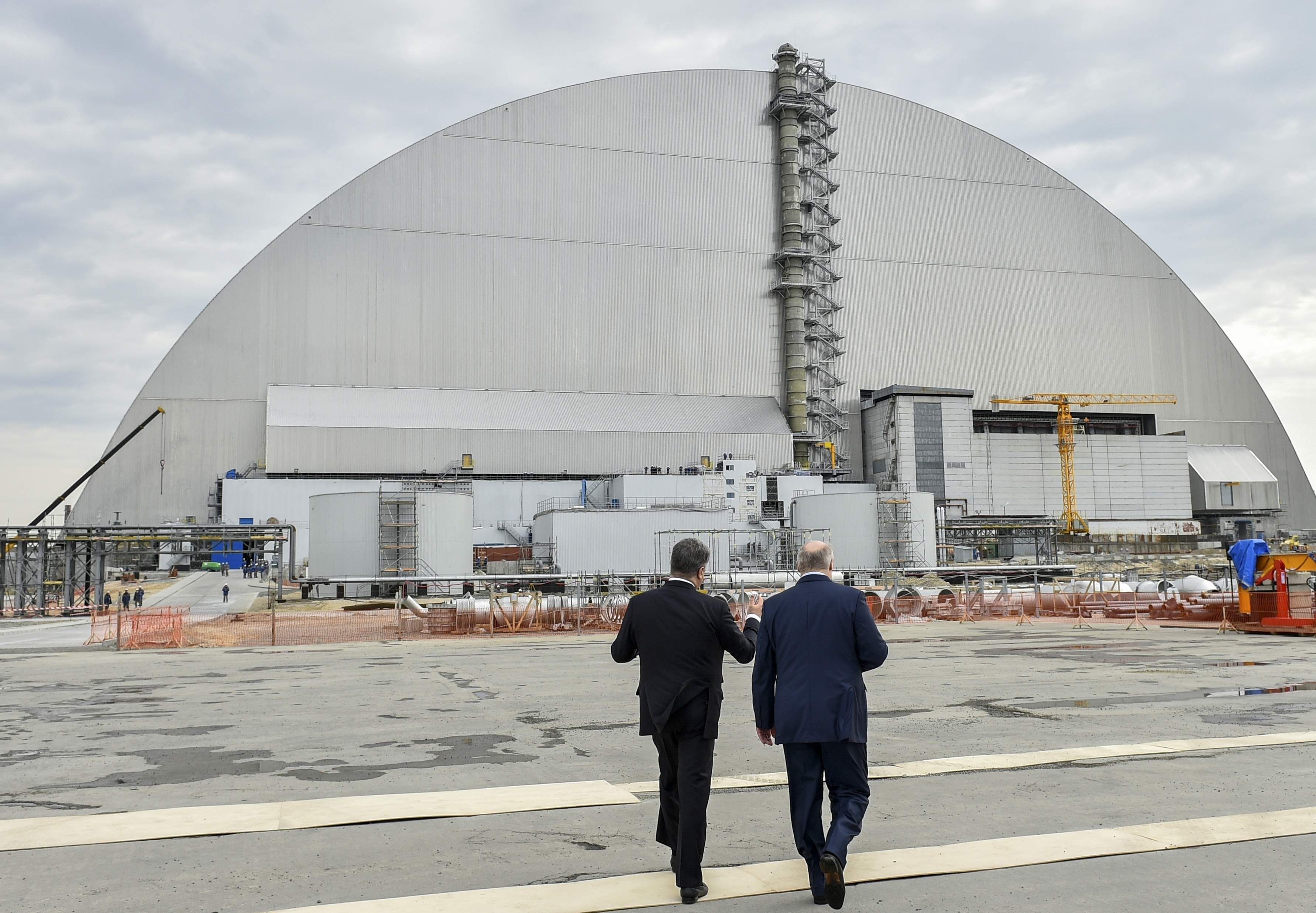 Ukrainian President Petro Poroshenko, left, and Belarusian President Alexander Lukashenko visit the Chernobyl nuclear power plant in Chernobyl, Ukraine, Wednesday, April 26, 2017, marking the 31st anniversary of the Chernobyl nuclear disaster. A reactor at the Chernobyl nuclear power plant exploded on April 26, 1986, leading to an explosion and the subsequent fire spewed a radioactive plume over much of northern Europe. THE ASSOCIATED PRESS