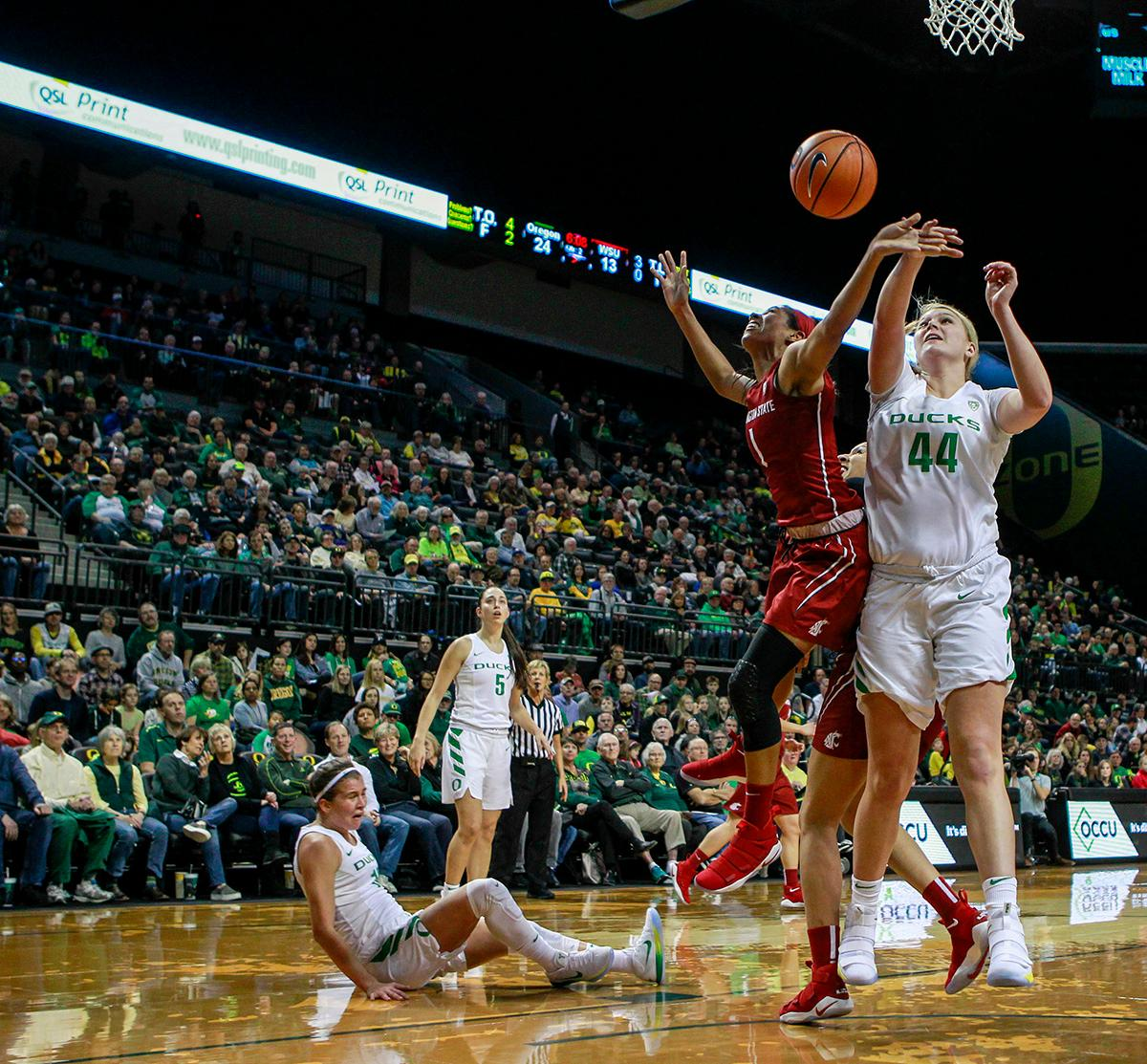 Washington State University Cougars Caila Hailey (#1) and Oregon Ducks Hallory McGwire (#44) fight for a rebound. In their first conference basketball game of the season, the Oregon Women Ducks defeated the Washington State Cougars 89-56 in Matt Knight Arena Saturday afternoon. Oregon's Ruthy Hebard ran up 25 points with 10 rebounds. Sabrina Ionescu shot 25 points with five three-pointers and three rebounds. Lexi Bando added 18 points, with four three-pointers and pulled down three rebounds. Satou Sabally ended the game with 14 points with one three-pointer and two rebounds. The Ducks are now 12-2 overall with 1-0 in conference and the Cougars stand at 7-6 overall and 0-1 in conference play. The Oregon Women Ducks next play the University of Washington Huskies at 1:00 pm on Sunday. Photo by Rhianna Gelhart, Oregon News Lab
