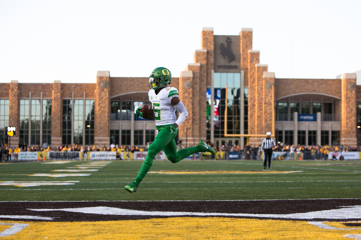 Oregon wide receiver Taj Griffin (#5) runs into the endzone in with no defenders in sight. The Oregon Ducks lead the Wyoming Cowboys 42 to 10 at the end of the first half on Saturday, September 16, 2017 in Laramie, Wyo. Photo by Austin Hicks, Oregon News Lab