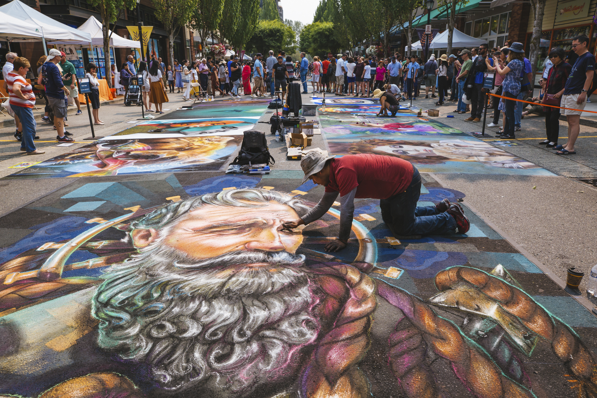 Over 50,000 people from all over the country came to Redmond, WA this past weekend to see chalk artists create stunning murals on the streets. Artists were given free reign to create whatever they wished, which resulted in a amazing variety of works that will last until the next rain! (Image: Sunita Martini / Seattle Refined)