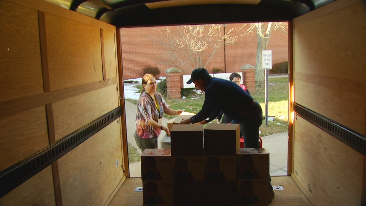 United Way volunteers helped unload food boxes, provided by Hearts With hands, at Buncombe County schools' main offices on Thursday. (Photo credit: WLOS staff)