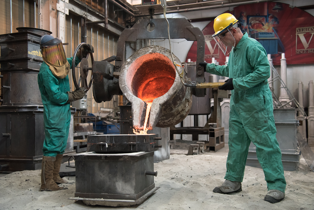 It is rare that the public is able to witness the casting of a Verdin bell inside the Kellogg Avenue foundry. Molten metal is heated to extreme temperatures and carefully poured into casts by trained technicians wearing protective outfits. Cincinnati Refined was invited to witness a pouring on September 27th, 2018. / Image: Phil Armstrong, Cincinnati Refined // Published: 10.19.18