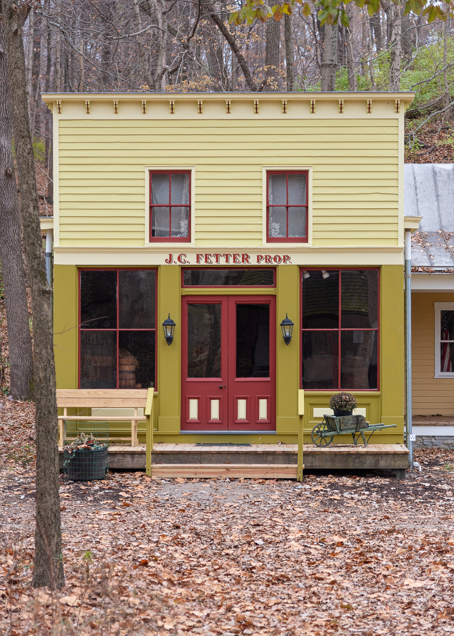 Owensville in Clermont County was once known as Boston. In Boston, the Fetter General Store stood along Main Street. It was built in 1866 and belonged to John C. Fetter in the the 1870s. The store was restored and moved to Heritage Village in 1983, where it now connects to the Schram Print Shop, a newer building made to replicate an old building that's filled with old printing press artifacts and machinery.{ }/ Image: Phil Armstrong, Cincinnati Refined // Published: 12.5.19