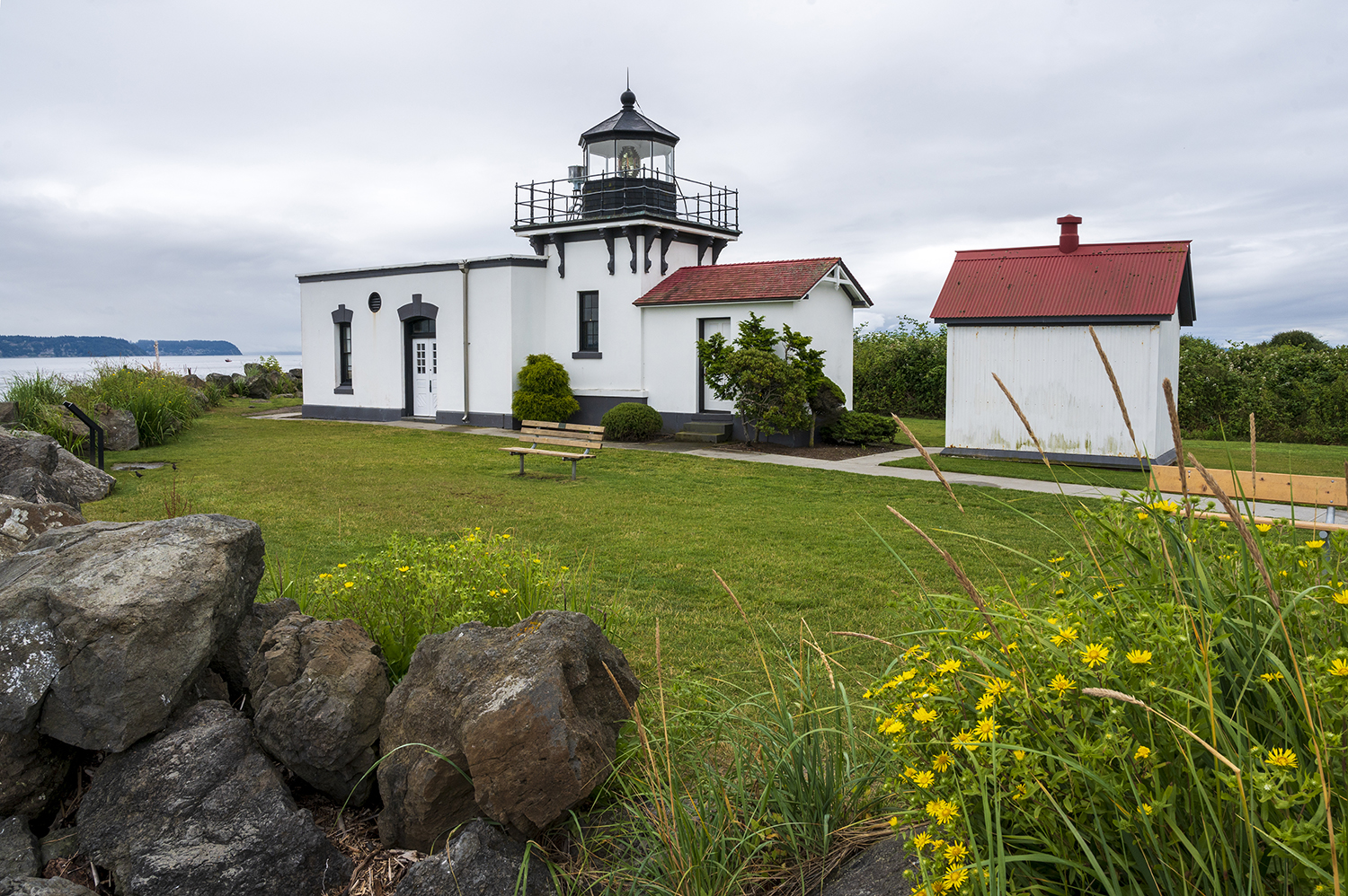 Point No Point Lighthouse is situated on the Kitsap Peninsula of the Puget Sound and still provides active navigational aid today. Opened in 1879, the first light signal was created using a kerosene lamp, and then upgraded to a Fresnel lens in 1880. (Image: Rachael Jones / Seattle Refined)