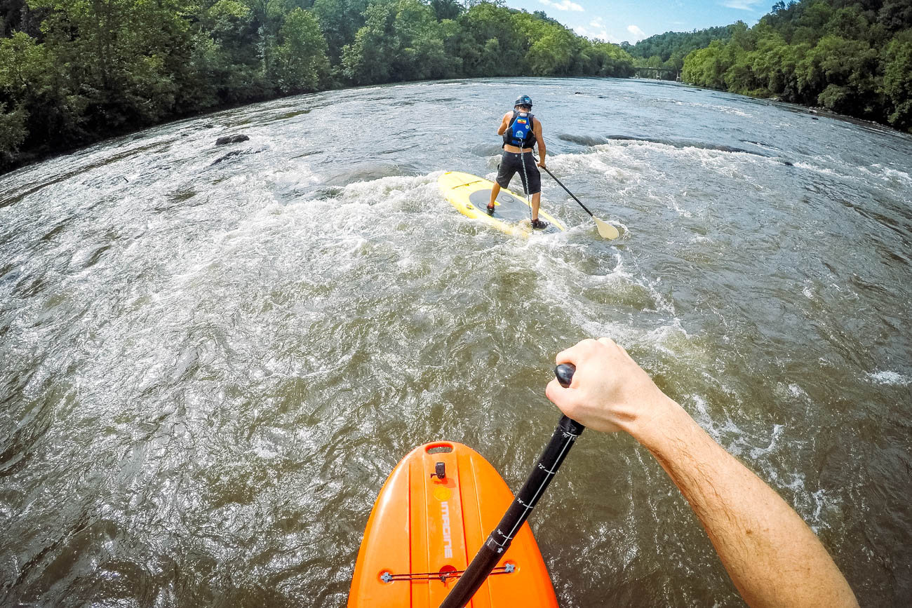 Feeling adventurous during your visit? Why not try stand up paddleboarding on the French Broad River / Image courtesy of Explore Asheville // Published: 12.29.18