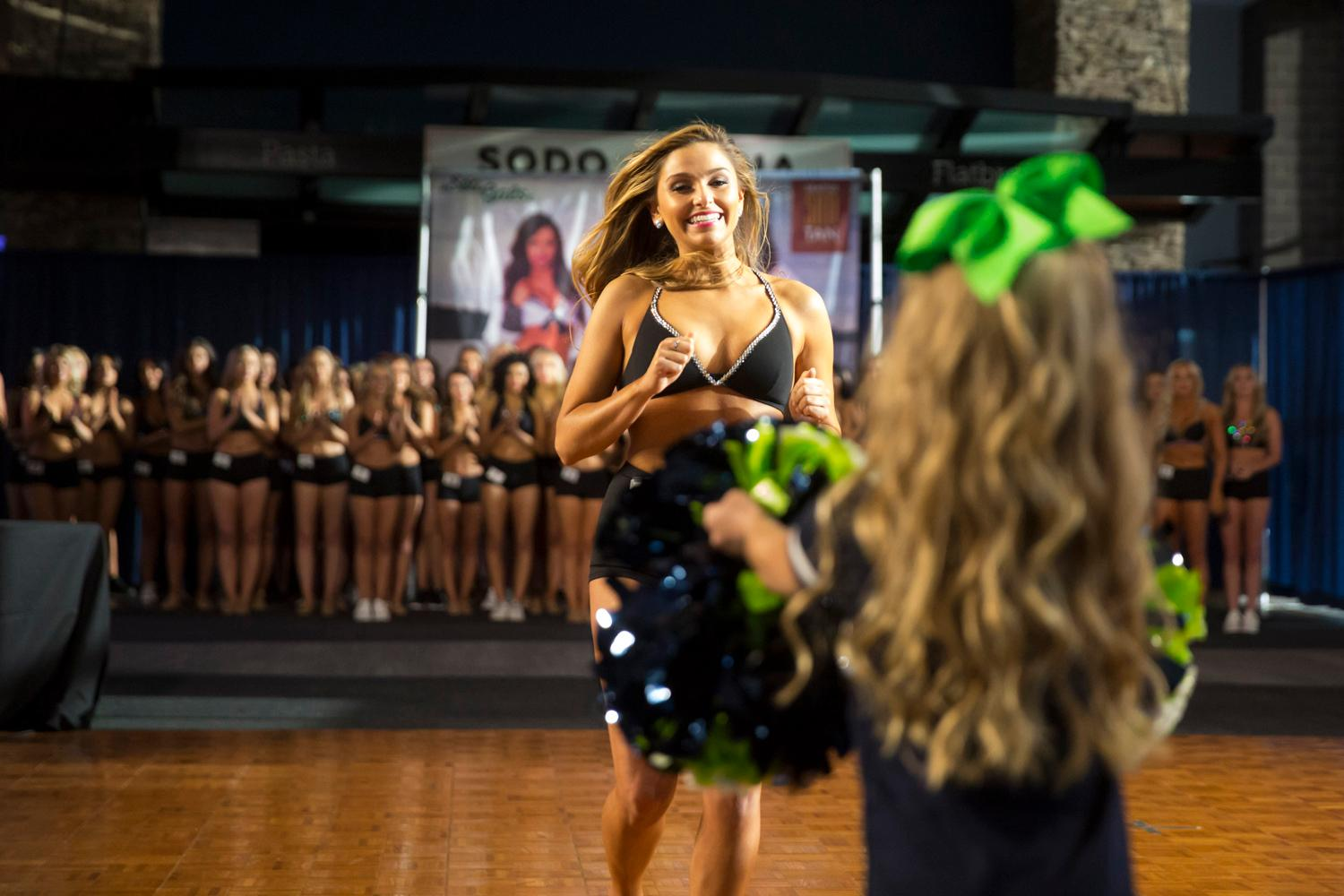 Welcome Ashley, a 2018 Sea Gal! Dancers performed a choreographed routine and spoke briefly about themselves. The entire evening was live broadcasted on the Seahawks website. (Sy Bean / Seattle Refined)