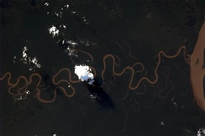A squiggly little river feeds the mighty Amazon. (Photo & Caption: Chris Hadfield/NASA)