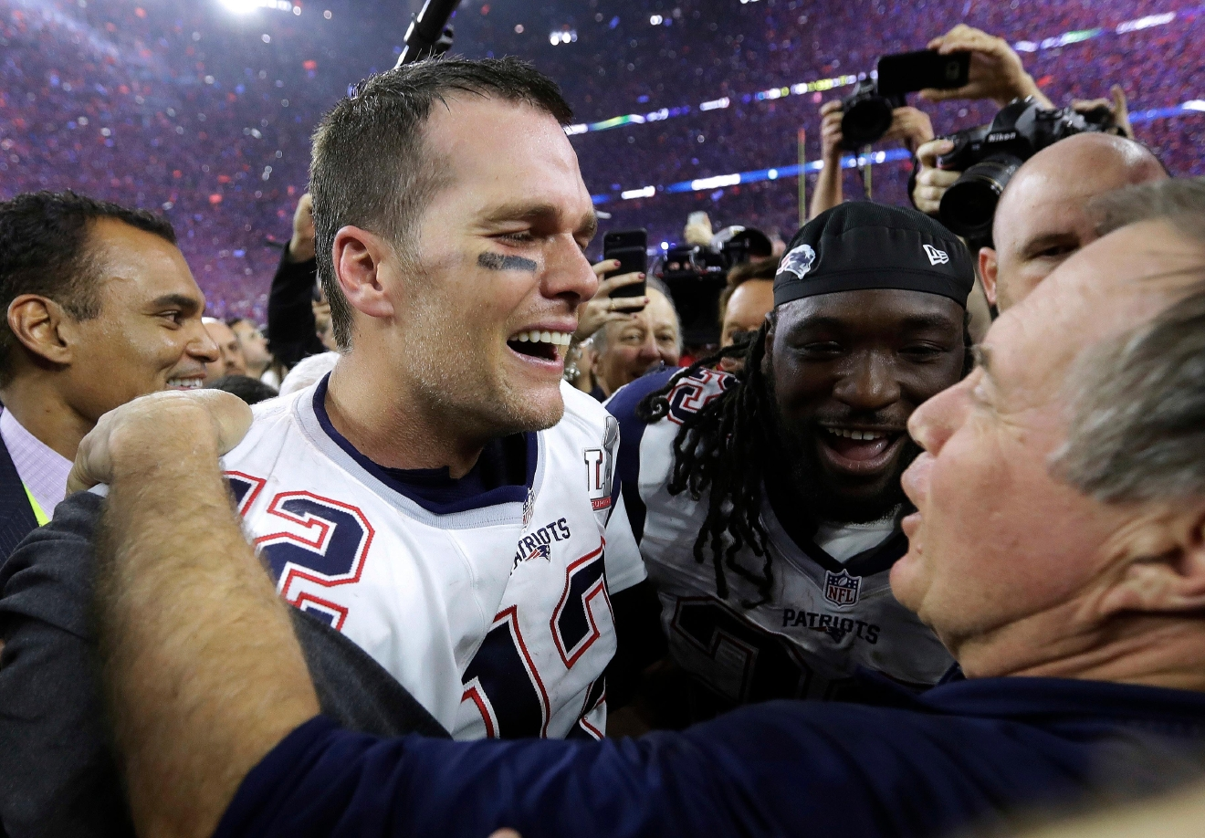 FILE - In this Feb. 5, 2017, file photo, New England Patriots' Tom Brady celebrates with coach Bill Belichick after the Patriots defeated the Atlanta Falcons 34-28 in overtime in the NFL Super Bowl 51 football game in Houston. A new book and a movie are in the works about Brady and the suspension he overcame to earn an unprecedented fifth Super Bowl ring. (AP Photo/David J. Phillip, File)