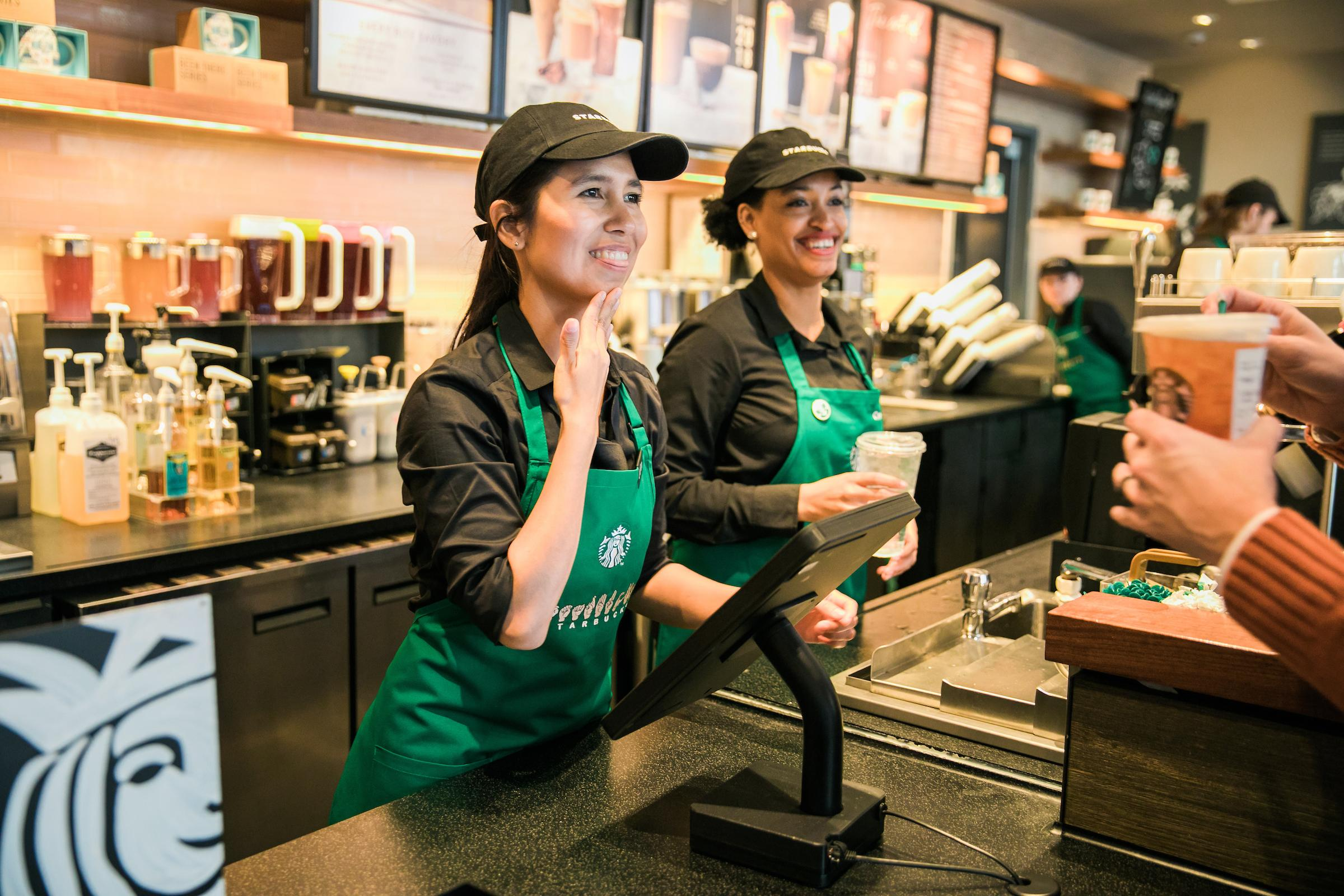 Although not every employee is Deaf, everyone who works at the new Starbucks is fluent in ASL.{ }(Image: Joshua Trujillo, Starbucks)
