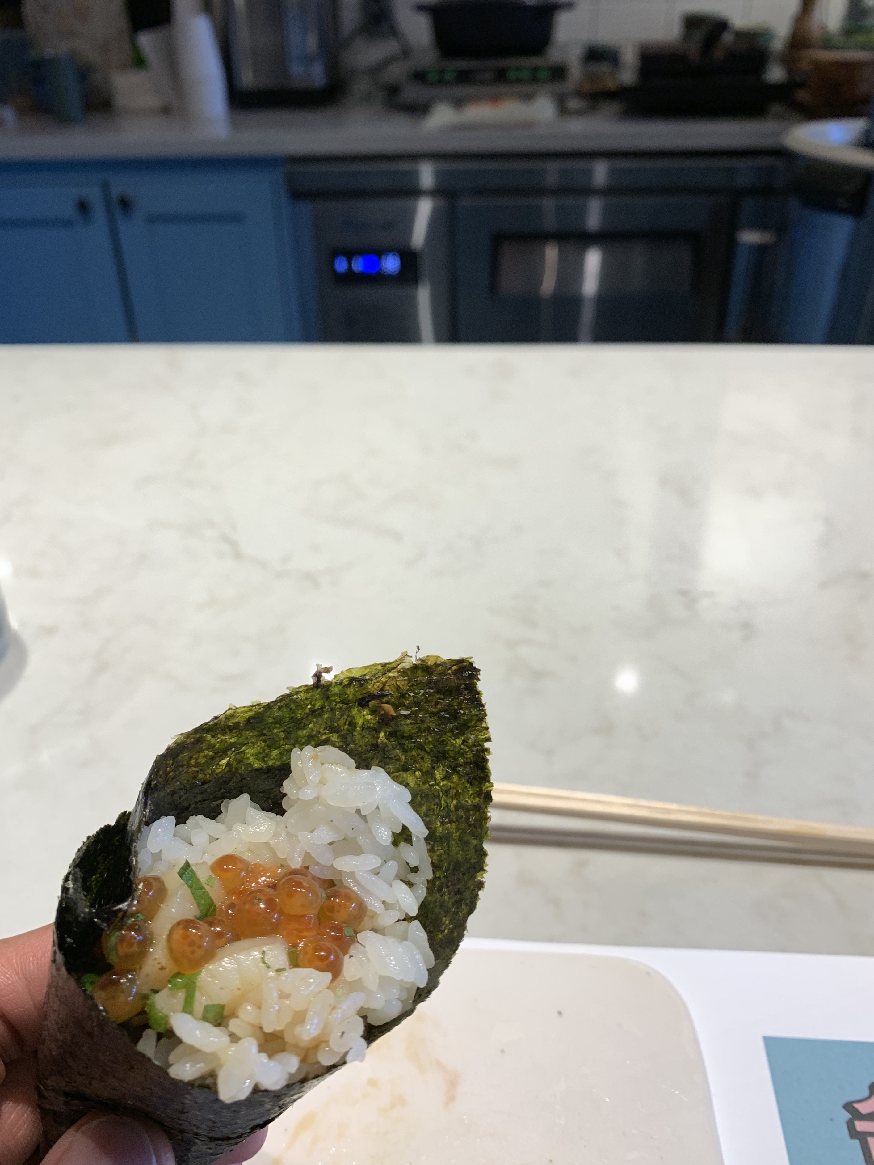 Seared scallops with salmon roe hand roll. (Image: Frank Guanco)