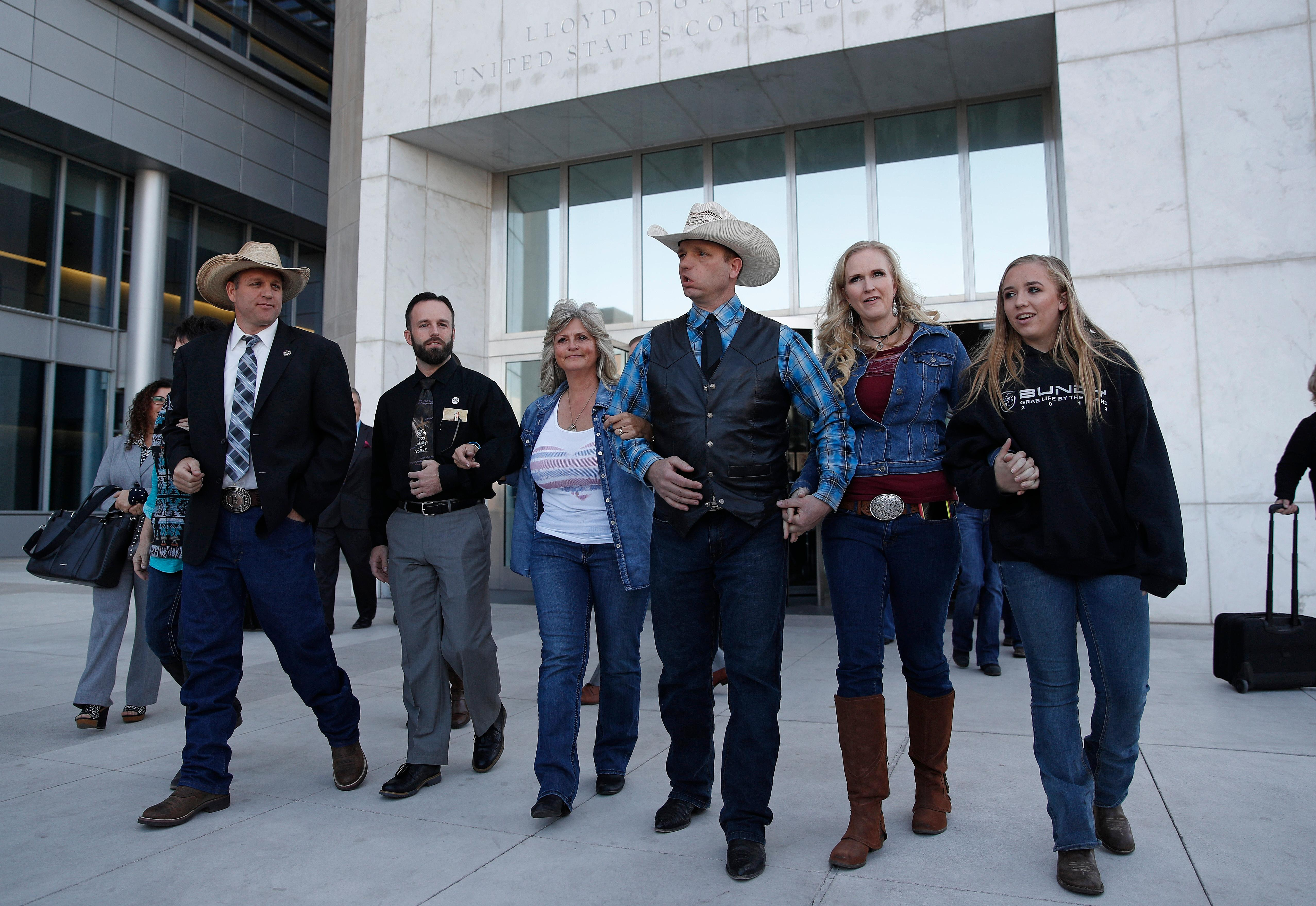 "From left, Ammon Bundy, Ryan Payne, Jeanette Finicum, widow of Robert ""LaVoy"" Finicum, Ryan Bundy, Angela Bundy, wife of Ryan Bundy and Jamie Bundy, daughter of Ryan Bundy, walk out of a federal courthouse Wednesday, Dec. 20, 2017, in Las Vegas. Chief U.S. District Judge Gloria Navarro declared a mistrial Wednesday in the case against Cliven Bundy, his sons Ryan and Ammon Bundy and self-styled Montana militia leader Ryan Payne. (AP Photo/John Locher)"