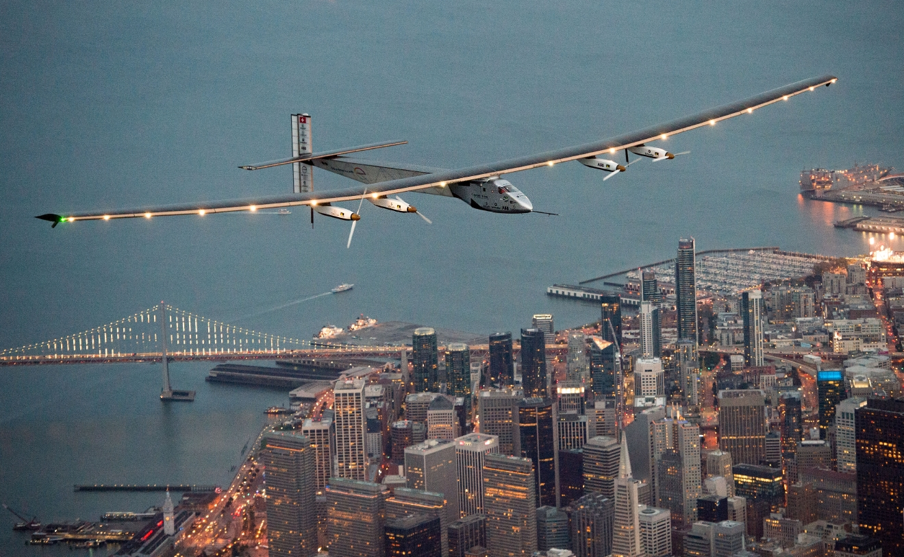 Solar Impulse 2 flies over San Francisco, Saturday, April 23, 2016. The solar-powered airplane, which is attempting to circumnavigate the globe to promote clean energy and the spirit of innovation, arrived from Hawaii after a three-day journey across the Pacific Ocean. (AP Photo/Noah Berger)