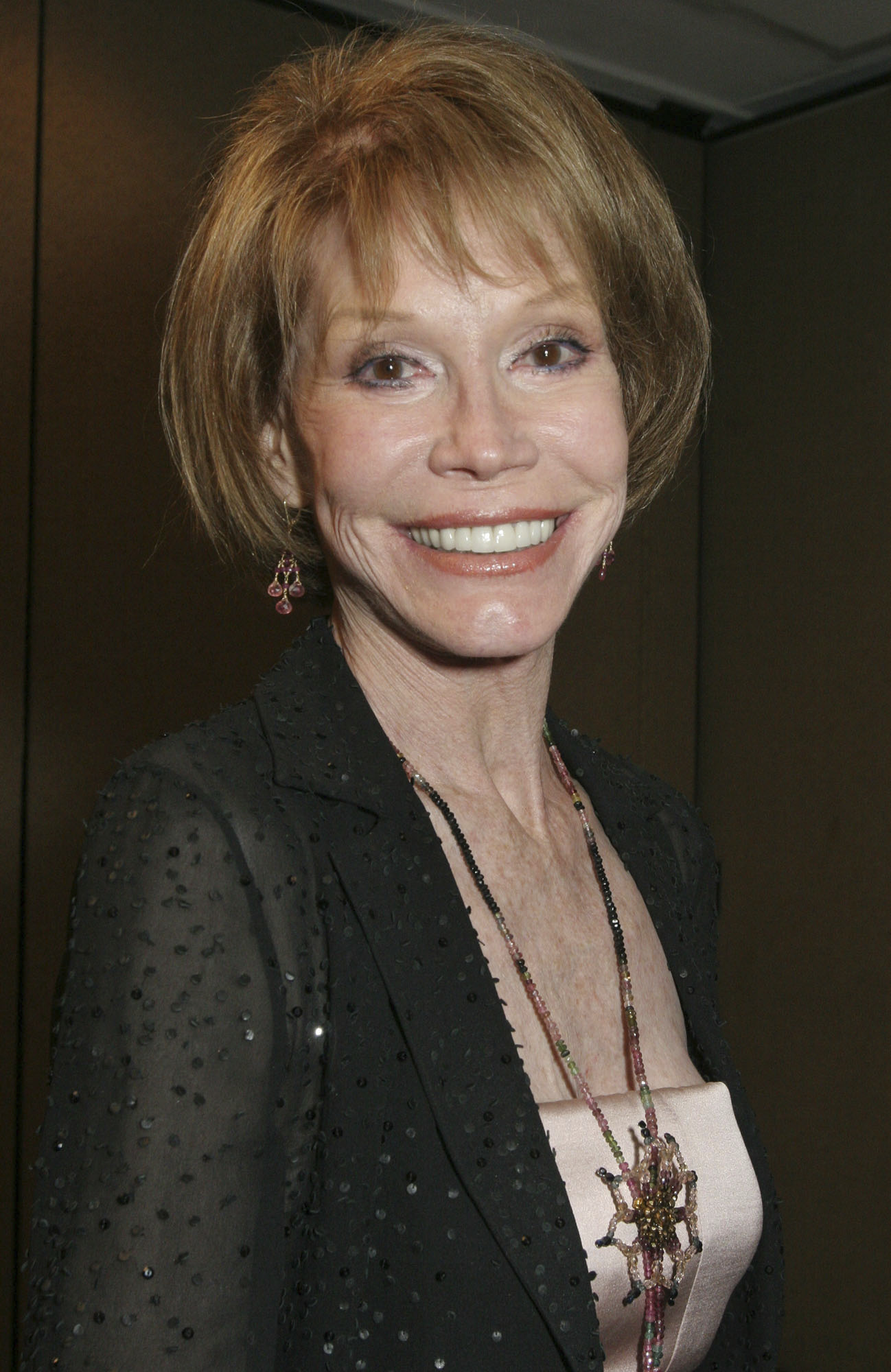 CORRECTS DATE OF PHOTO TO 2005  FILE - This Sept. 19, 2005, file photo shows Mary Tyler Moore at the 26th Annual News and Documentary Emmy Awards ceremony in New York. Moore died Wednesday, Jan. 25, 2017, at age 80. (AP Photo/Tina Fineberg, File)