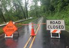 Wilson Road in closed after heavy rains on Wednesday washed out about a third of the road. (Photo credit: WLOS Staff)