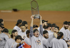 The Houston Astros celebrate with the trophy after their win against the Los Angeles Dodgers in Game 7 of the World Series Wednesday, Nov. 1, 2017, in Los Angeles. The Astros won 5-1 to win the series 4-3.