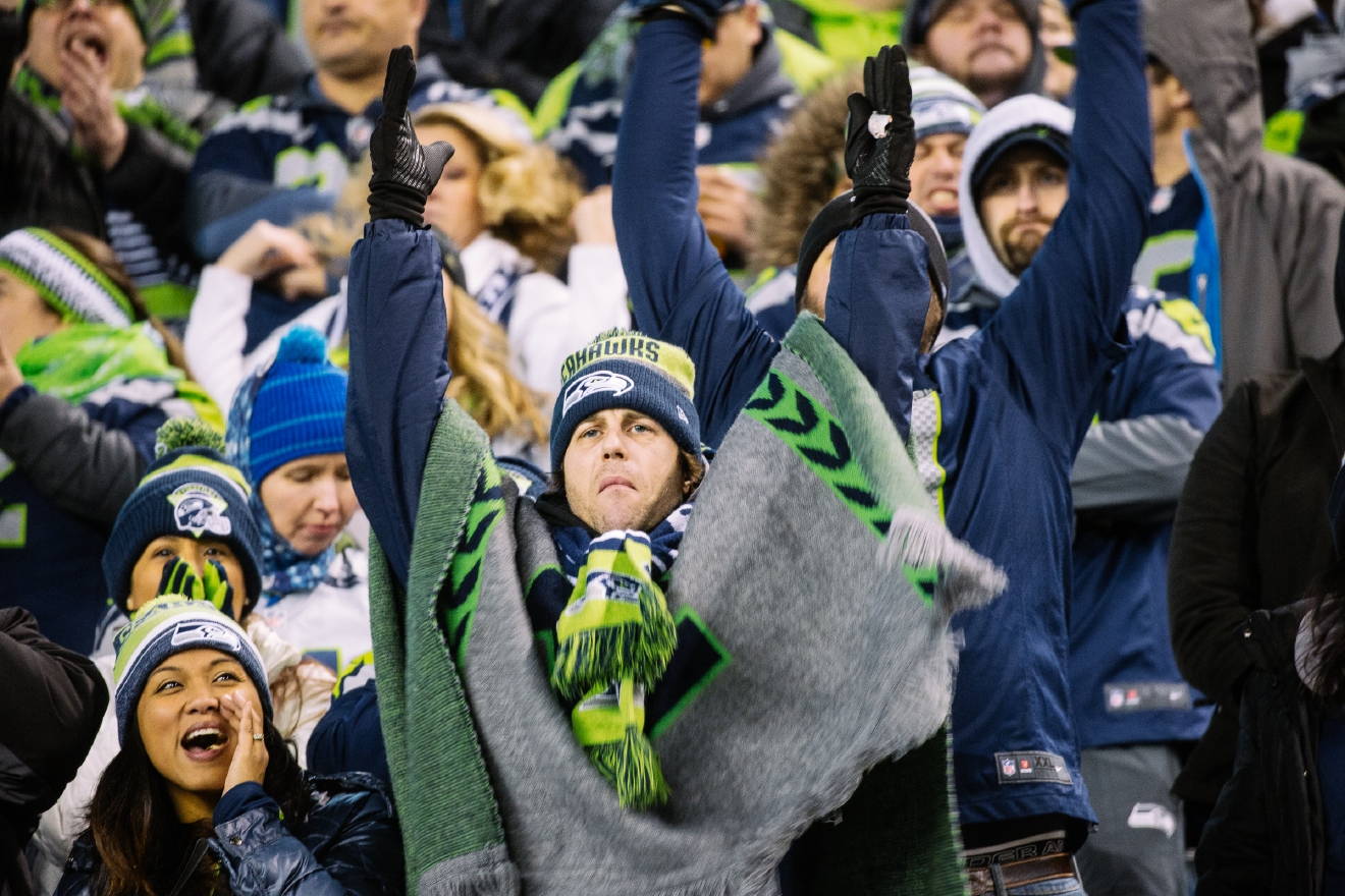 12s are getting loud as the Seattle Seahawks take on the Detroit Lions in the Wildcard Playoff Round. The Seahawks are playing under the lights on prime time for the chance to play the Atlanta Falcons next weekend. (Image: Joshua Lewis / Seattle Refined)