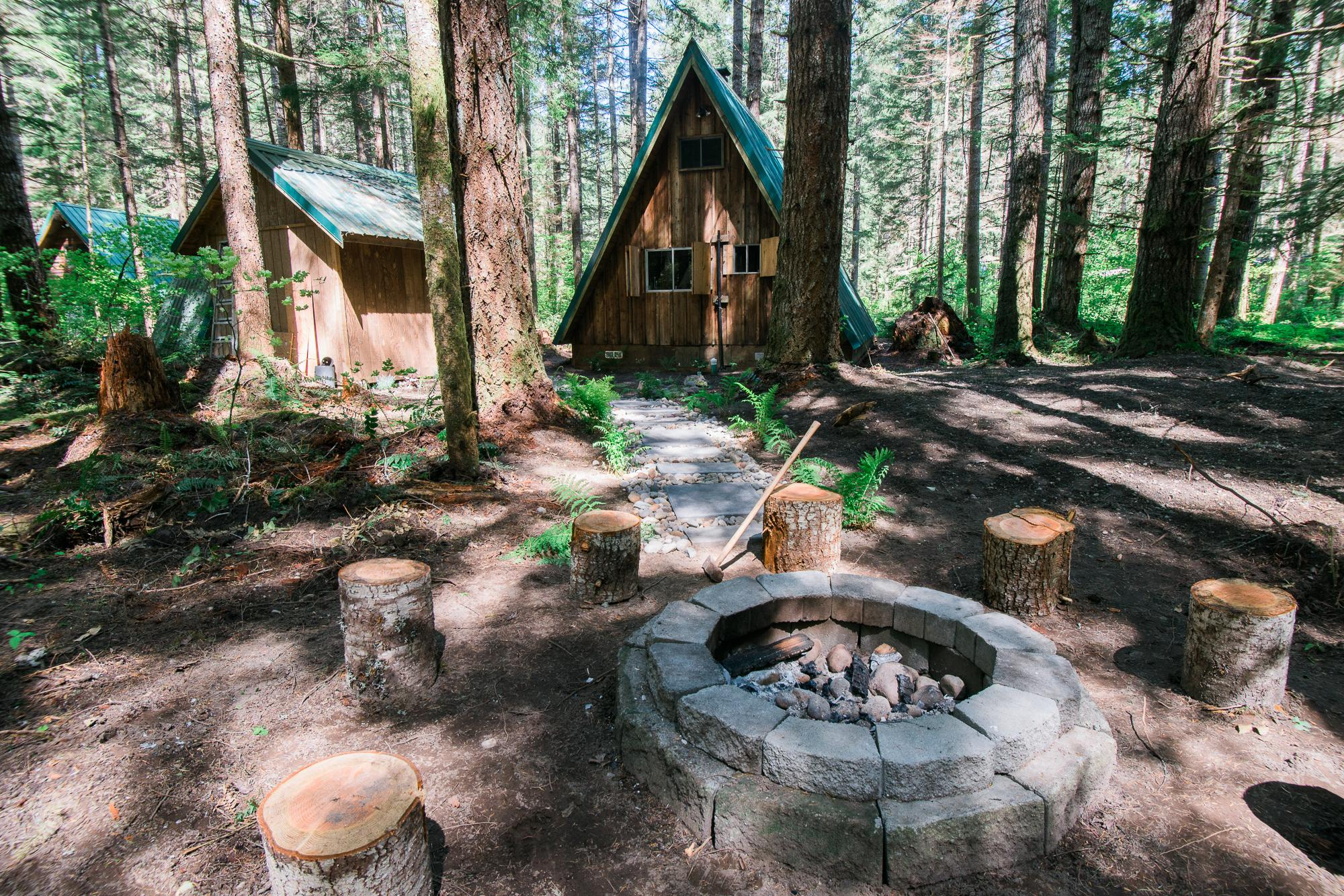 "This rental in Ashford, Washington is close to Mount Rainier and is as cute as can be! It's a quaint 700 square foot cabin that is perfect for a weekend getaway for two (or one if you are looking for a quiet weekend by yourself - WE GET IT.) Nicknamed ""Hebe's Hideout"" the cabin has been recently remodeled and is a short stroll away from the Nisqually River. Even though you are in the woods however there is wifi in the cabin and a new flat screen TV and DVD player. Hebe's Hideout is one bedroom, one bath and is $167 per night. You can book Hebe's Hideout through VRBO! (Image courtesy of Amelia Chavez / VRBO)."