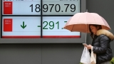 Global stocks weaker as US health overhaul failure lingers