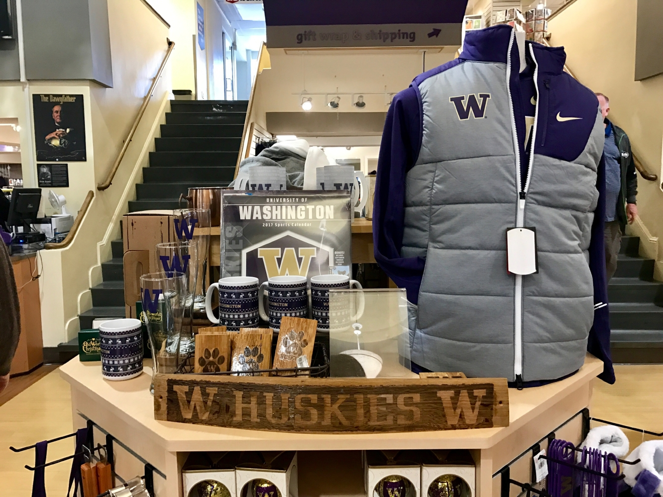 Whether you're a current student, alum, or just *love* the Dawgs, it's a pretty exciting time to be a Husky fan right now. Just to catch you up, the University of Washington football team is having one of their best seasons in years, and will be playing the Peach Bowl in Atlanta on December 31st. If you know a Dawg fan, they're probably salivating at the mouth right about now. Which is why it's a perfect time to give them a themed gift! Here are some of the coolest Husky gear we saw at the University Bookstore on the Avenue during our last visit. Pro Tip: They're open 10 a.m. - 7 p.m. on Christmas Eve! (Image: Britt Thorson / Seattle Refined)