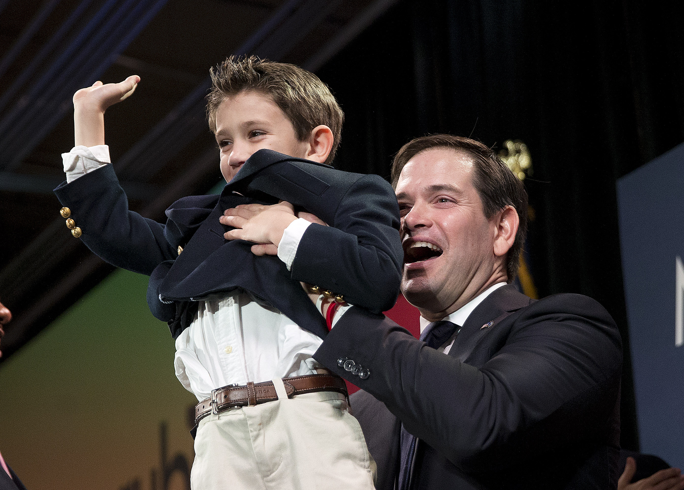 Republican presidential candidate Sen. Marco Rubio, R-Fla, lifts up his son, Dominick, after speaking during an election-night rally Saturday, Feb. 20, 2016, in Columbia, S.C. (AP Photo/John Bazemore)
