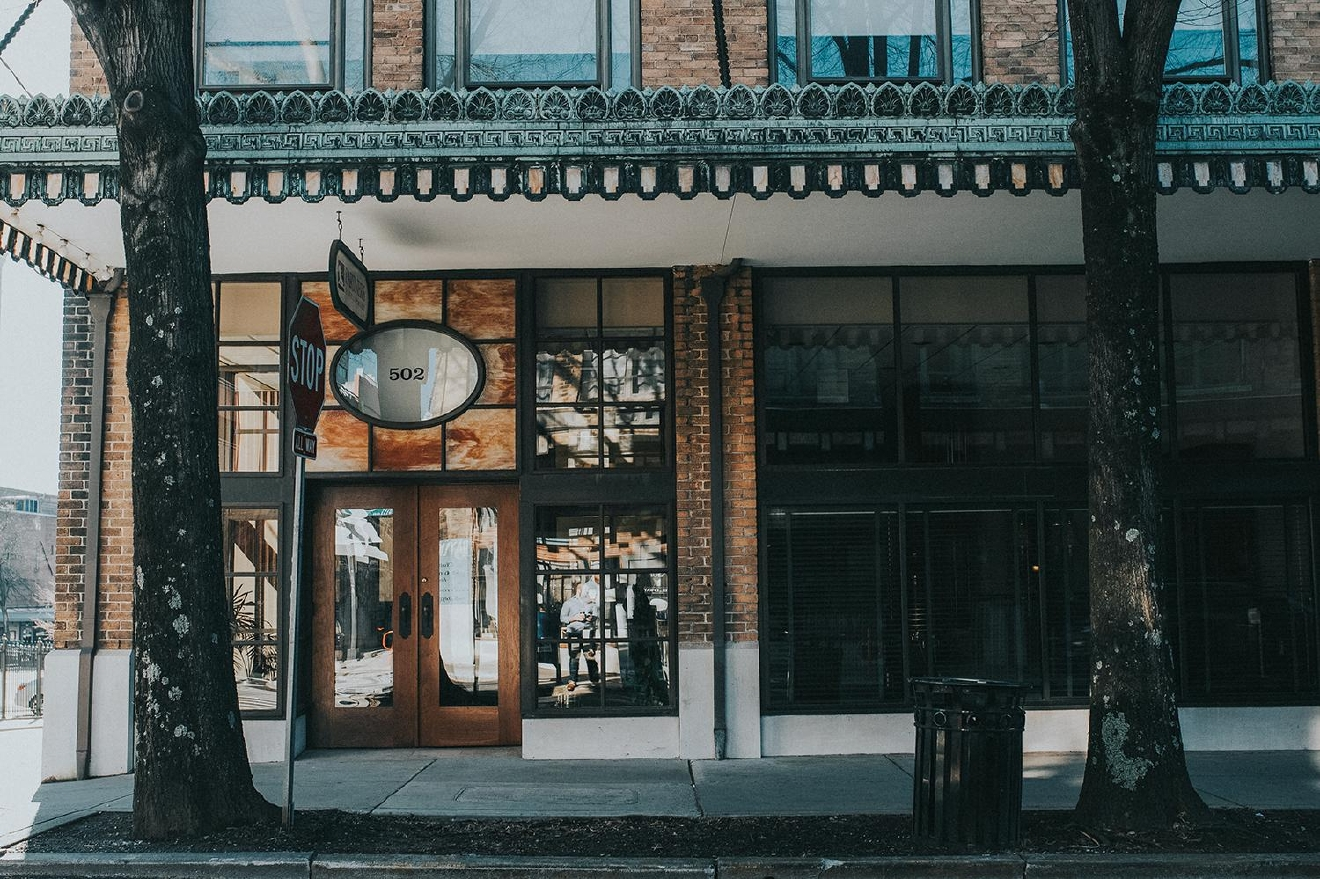 "PICTURED: One of the many unique storefronts / ABOUT: Knoxville is nicknamed ""the Queen City of the Mountains."" At only a three and a half hour drive down I-75, take a day trip down and check out everything the city has to offer. Then, head southeast and enjoy the American wilderness that lies just beyond it. / Image: Brianna Long // Published: 2.5.17"