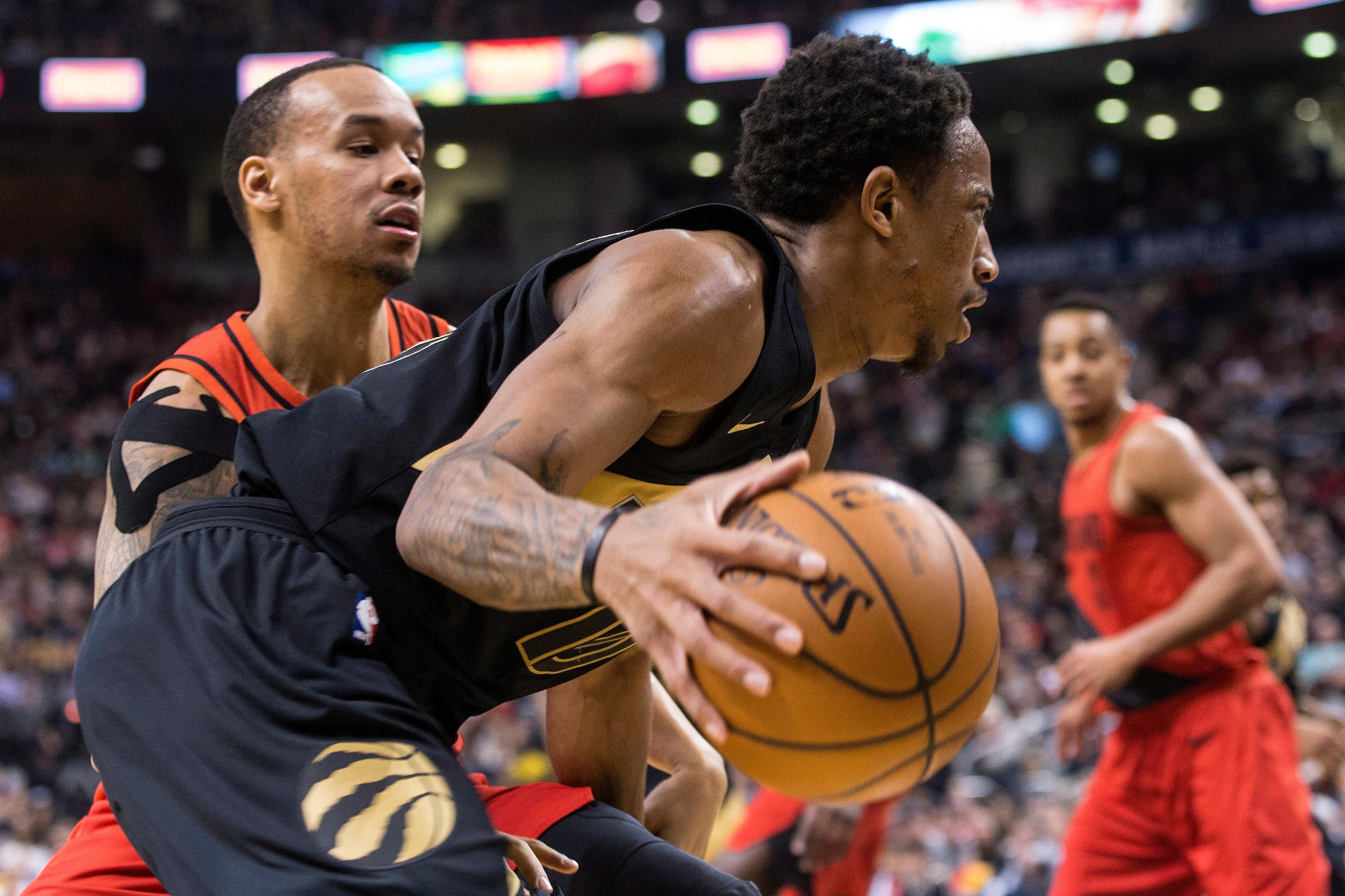 Toronto Raptors DeMar DeRozan drives past Portland Trail Blazers Shabazz Napier, left, during the second half of an NBA basketball game Friday, Feb. 2, 2018, in Toronto. (Chris Young/The Canadian Press via AP)