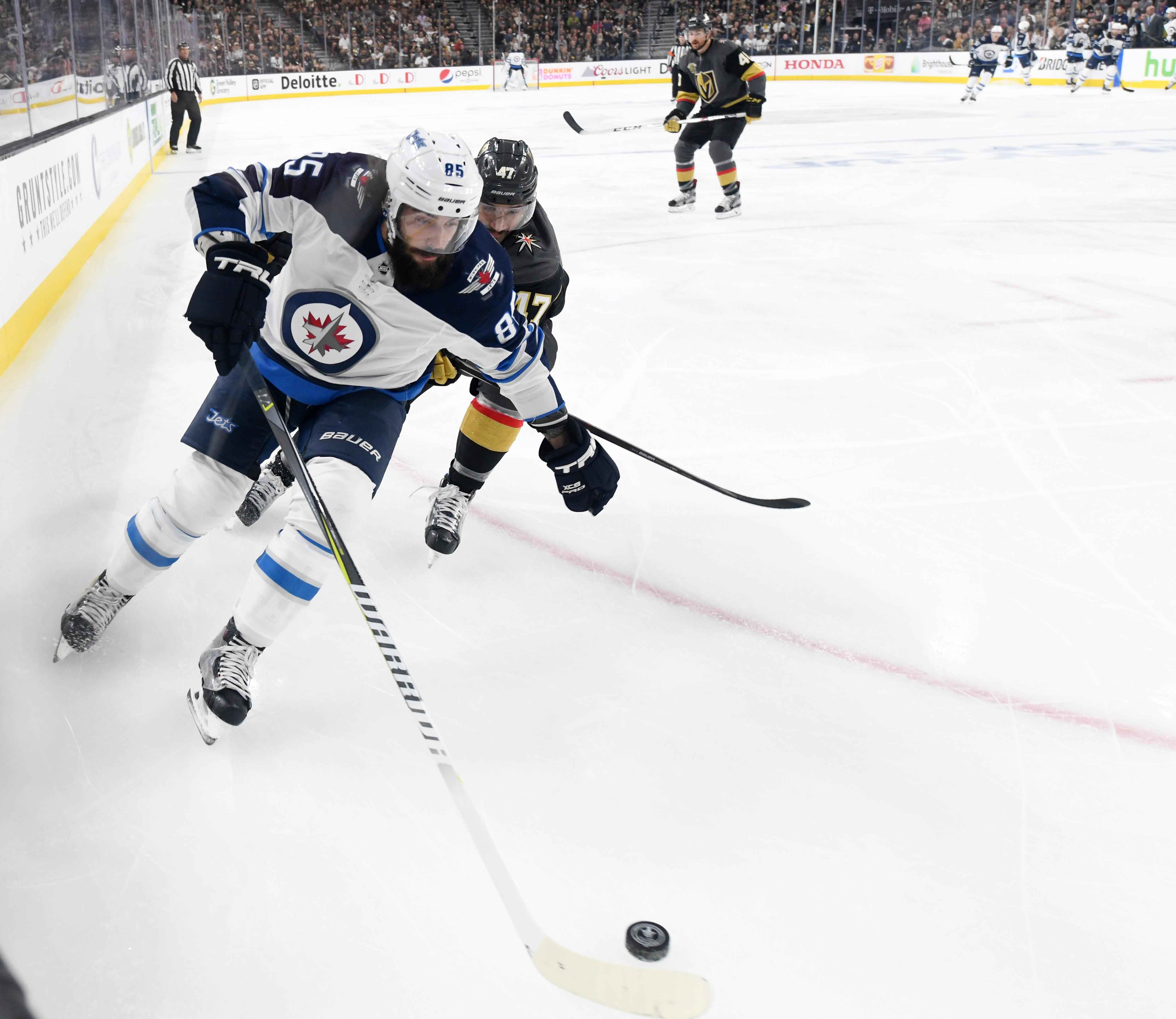 Vegas Golden Knights defenseman Luca Sbisa (47) chases Winnipeg Jets center Mathieu Perreault (85) during Game 3 of their NHL hockey Western Conference Final game Wednesday, May 16, 2018, at T-Mobile Arena. CREDIT: Sam Morris/Las Vegas News Bureau