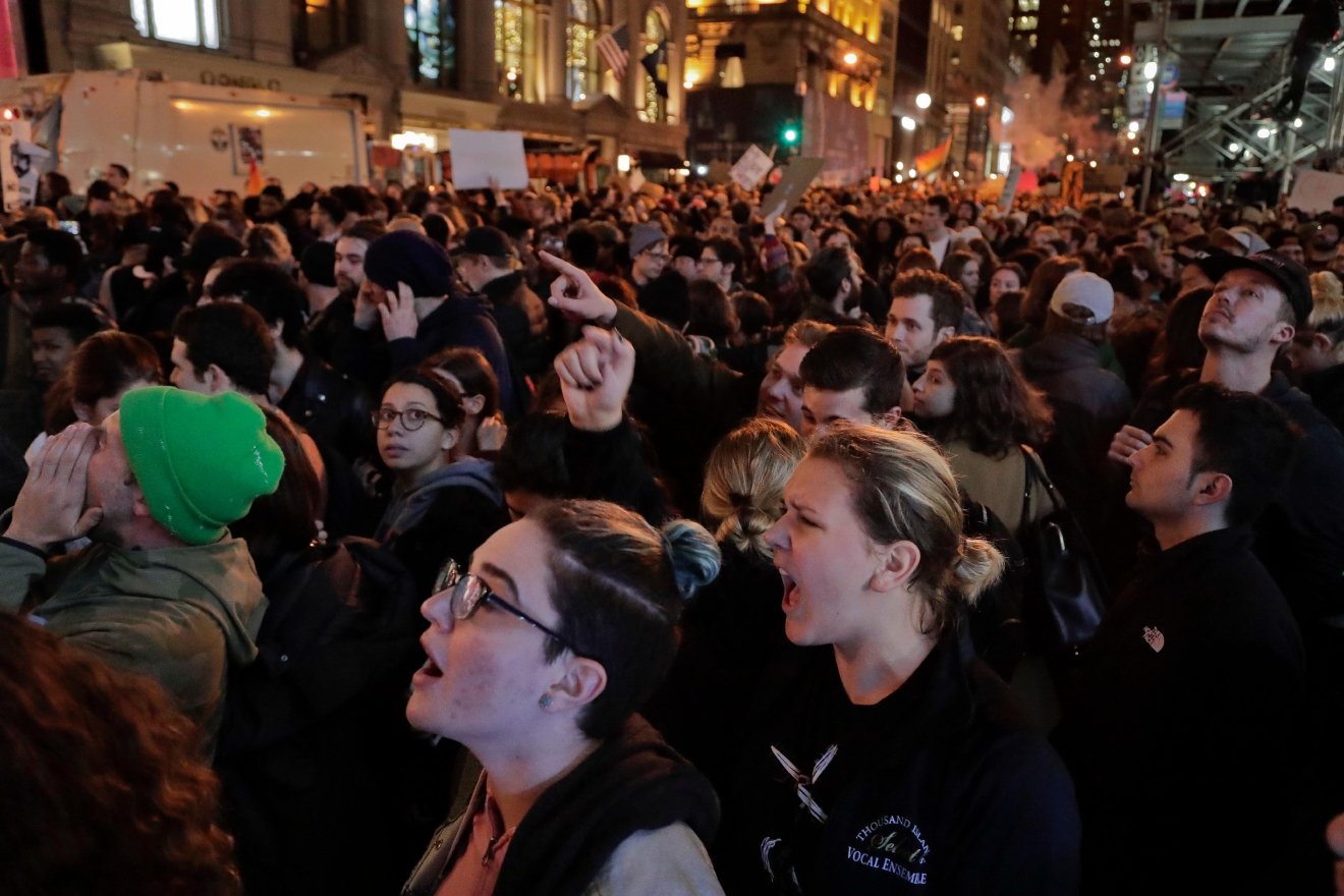 Protesters chant slogans on Fifth Avenue outside Trump Tower, Wednesday, Nov. 9, 2016, in New York. Thousands of protesters around the country took to the streets Wednesday to condemn the election of Donald Trump as president. (AP Photo/Julie Jacobson)