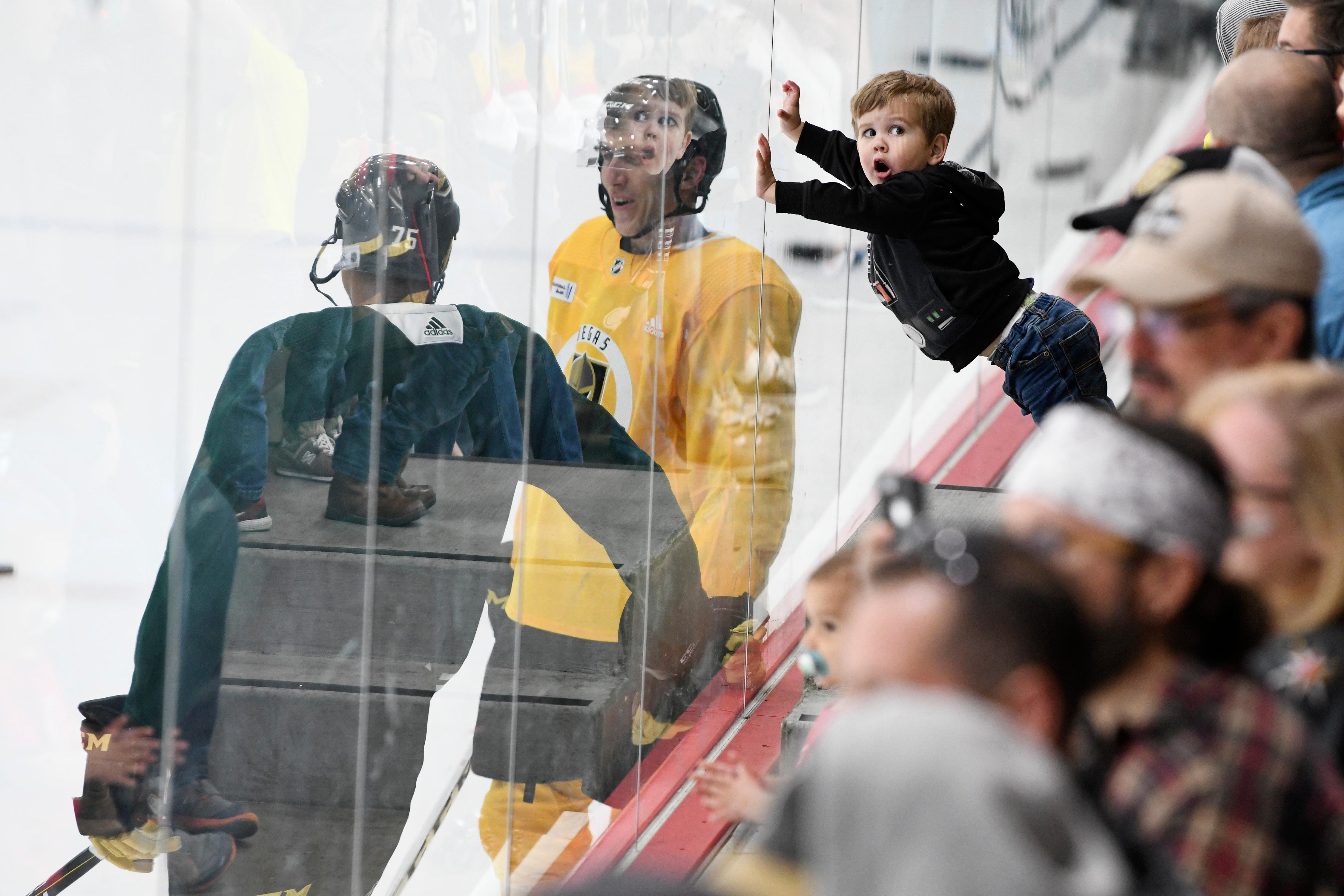 A young boy leans on the glass during the Vegas Golden Knights practice Friday, April 20, 2018, at City National Arena in Las Vegas. CREDIT: Sam Morris/Las Vegas News Bureau